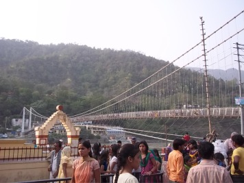 Yes, this is the bridge with motorcycles, monkeys, and cows